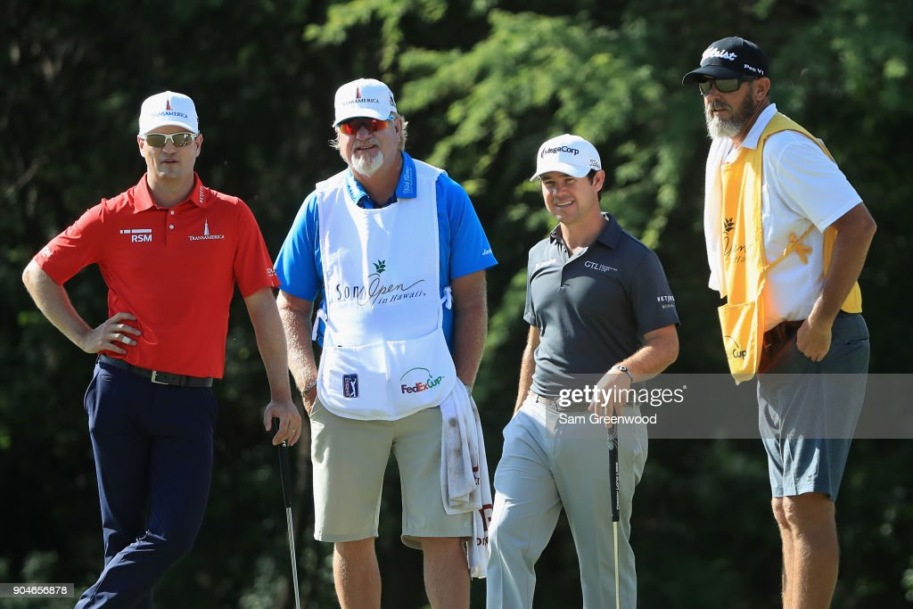 Zach Johnson and Brian Harman of the United States stand with their caddies on the seventh green during round three of the Sony Open In Hawaii at Waialae Country Club on January 13, 2018 in Honolulu, Hawaii.