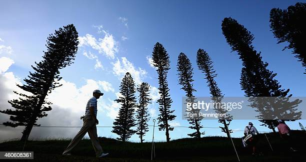 Zach Johnson and Jason Dufner walk to the tee box during round two of the Hyundai Tournament of Champions at the Plantation Course at Kapalua Golf...