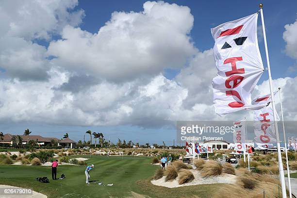 Zach Johnson and Tiger Woods practice chipping ahead of the Hero World Challenge at Albany The Bahamas on November 29 2016 in Nassau Bahamas