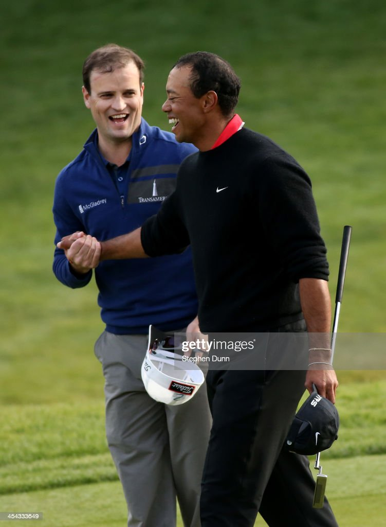 Zach Johnson (L) and Tiger Woods shake hands after they finished regulation play in a tie during the final round of the Northwestern Mutual World Challenge at Sherwood Country Club on December 8, 2013 in Thousand Oaks, California. Johnson went on the win on the first playoff hole.