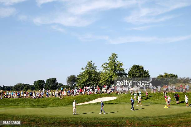 Zach Johnson Brian Harman and Steve Stricker walk to the tenth green during the first round of the John Deere Classic at TPC Deere Run on August 11...