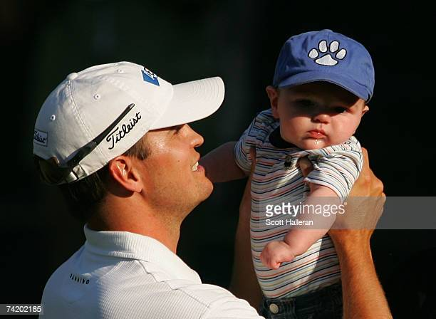 Zach Johnson celebrates with his son Will Johnson after defeating Ryuji Imada on the first playoff hole during the final round of the ATT Classic at...