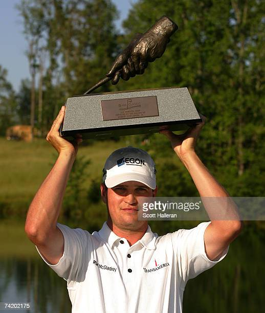 Zach Johnson celebrates with the trophy after his victory at the ATT Classic at the ATT Classic at TPC Sugarloaf on May 20 2007 in Duluth Georgia
