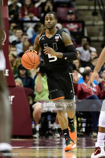 Zach Johnson guard University of Miami Hurricanes dribbles the basketball against the Florida State University Seminoles in an Atlantic Coast...