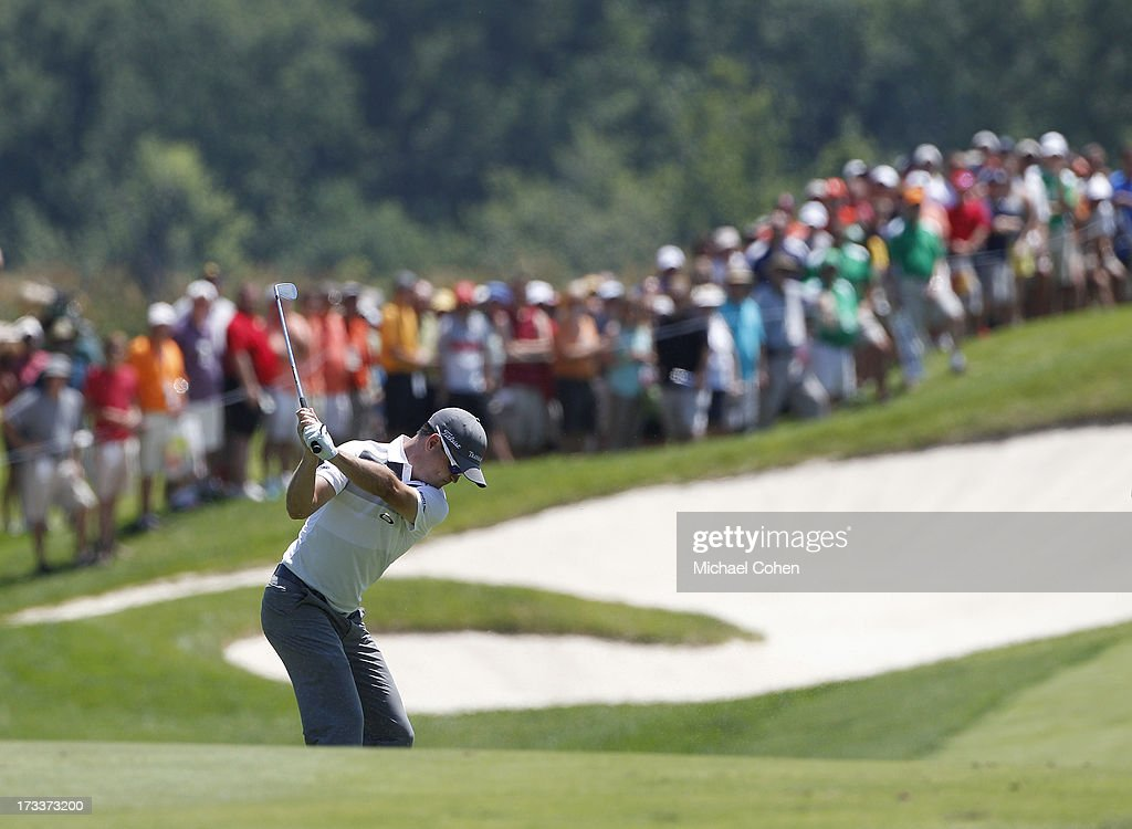 Zach Johnson hits a shot from the fairway during the second round of the John Deere Classic held at TPC Deere Run on July 12, 2013 in Silvis, Illinois.