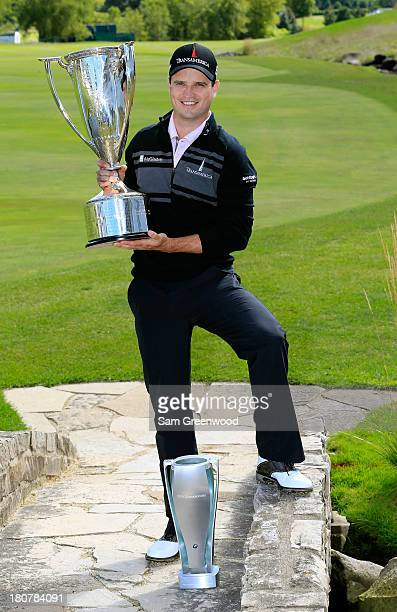 Zach Johnson holds the championship trophy after winning the BMW Championship at Conway Farms Golf Club on September 16, 2013 in Lake Forest,...