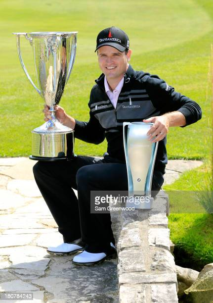 Zach Johnson holds the J.K. Wadley Trophy and the after winning the BMW Championship at Conway Farms Golf Club on September 16, 2013 in Lake Forest,...
