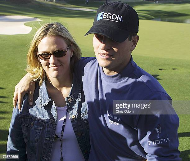 Zach Johnson is greeted by wife Kimala after winning the 2004 Bellsouth Classic at TPC at Sugarloaf in Duluth Georgia April 4 2004