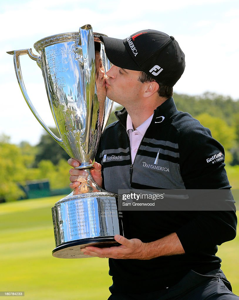 Zach Johnson kisses the J.K. Wadley Trophy after winning the BMW Championship at Conway Farms Golf Club on September 16, 2013 in Lake Forest, Illinois. Johnson finished with a score of -16.