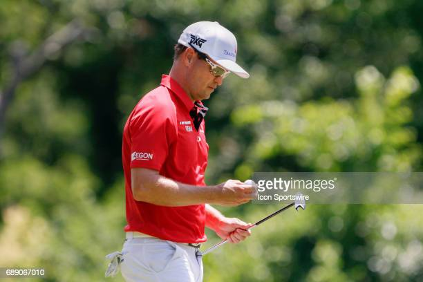Zach Johnson looks at his ball as he walks off the 8th green during the second round of the Dean Deluca Invitational on May 26 2017 at Colonial...