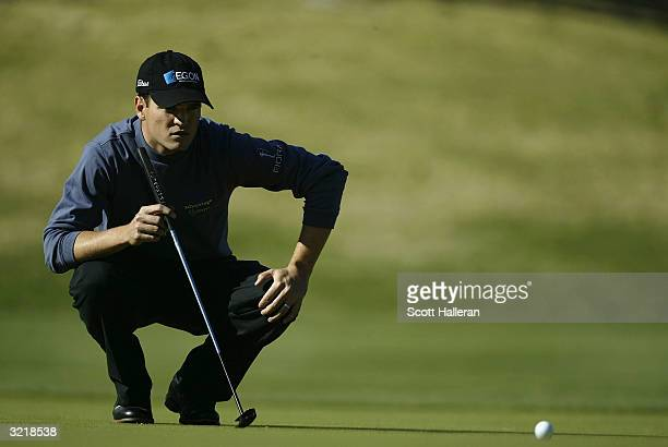 Zach Johnson looks over a putt during the final round of the BellSouth Classic at the TPC at Sugarloaf on April 4 2004 in Duluth Georgia