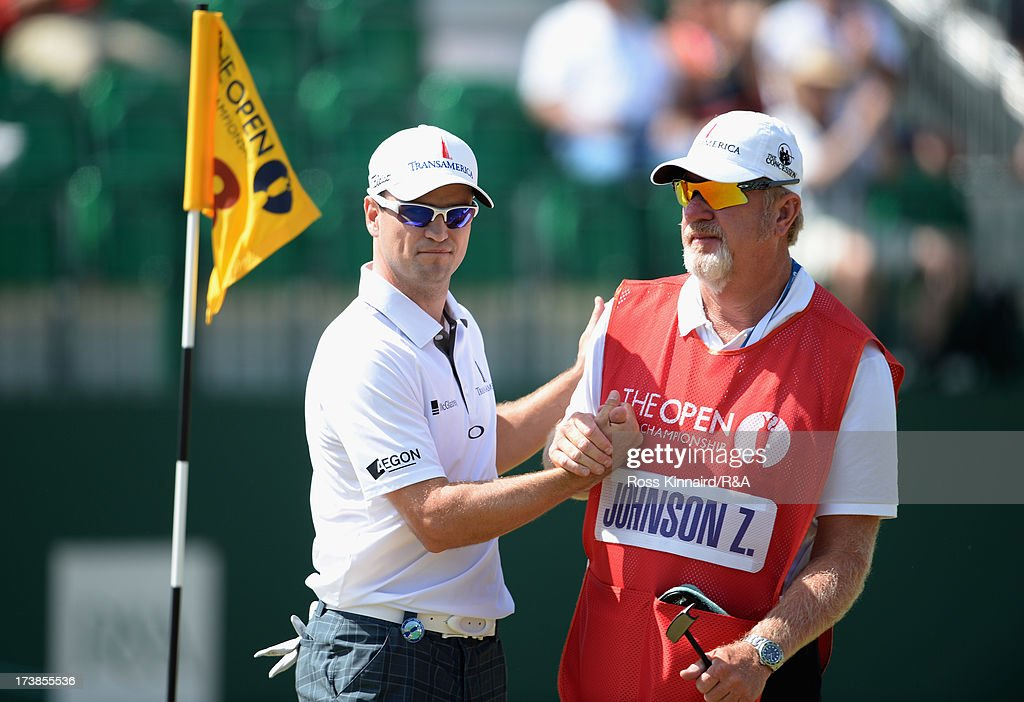 Zach Johnson of the United States and his caddie Damon Green shake hands on the 18th green during the first round of the 142nd Open Championship at Muirfield on July 18, 2013 in Gullane, Scotland.