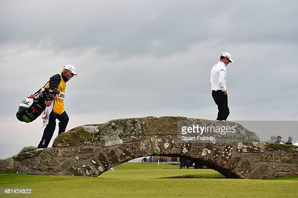 Zach Johnson of the United States and his caddie Damon Green walk over the Swilcan Bridge on the 18th hole in the playoff during the final round of...