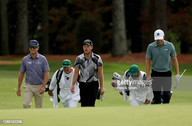 Zach Johnson of the United States, Danny Willett of England and Jordan Spieth of the United States walk up the 1fairway during a practice round prior...