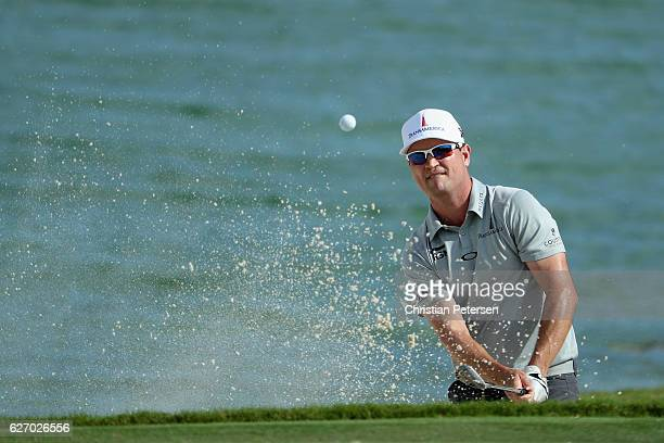 Zach Johnson of the United States plays a shot from a greenside bunker on the ninth hole during round one of the Hero World Challenge at Albany, The...