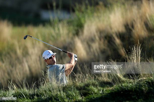 Zach Johnson of the United States plays his second shot on the 11th hole during the first round of The Barclays in the PGA Tour FedExCup PlayOffs on...