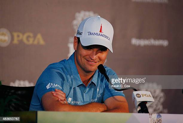Zach Johnson of the United States speaks to the media during a press conference in a practice round prior to the 2015 PGA Championship at Whistling...