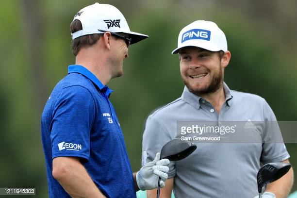 Zach Johnson of the United States talks to Tyrrell Hatton of England during a practice round prior to The PLAYERS Championship on The Stadium Course...