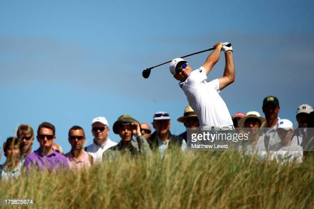 Zach Johnson of the United States tees off on the 14th hole during the first round of the 142nd Open Championship at Muirfield on July 18 2013 in...