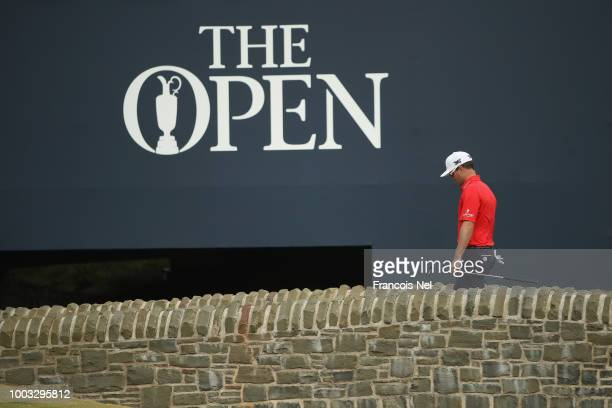Zach Johnson of the United States walks over a bridge on the 18th hole during the third round of the 147th Open Championship at Carnoustie Golf Club...