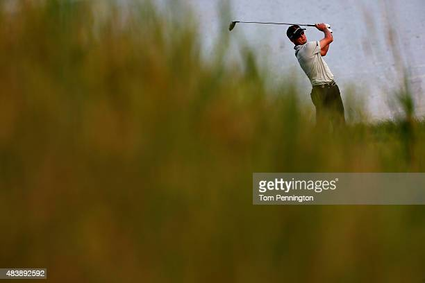Zach Johnson of the United States watches his tee shot on the 18th hole during the first round of the 2015 PGA Championship at Whistling Straits on...