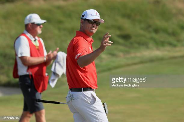 Zach Johnson of the United States waves after putting on the 18th green during the final round of the 2018 US Open at Shinnecock Hills Golf Club on...
