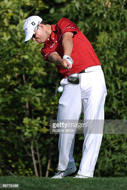 Zach Johnson of the US hits on the 10th tee during the first round at the 91st PGA Championship at the Hazeltine National Golf Club in Chaska,...