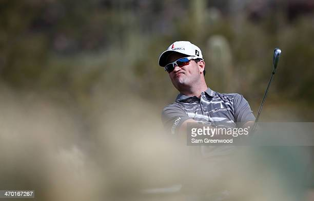 Zach Johnson plays a shot during a practice round prior to the World Golf ChampionshipsAccenture Match Play Championship at the Golf Club at Dove...