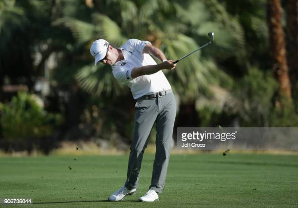 Zach Johnson plays his shot on the 18th hole during the first round of the CareerBuilder Challenge at La Quinta Country Club on January 18 2018 in La...
