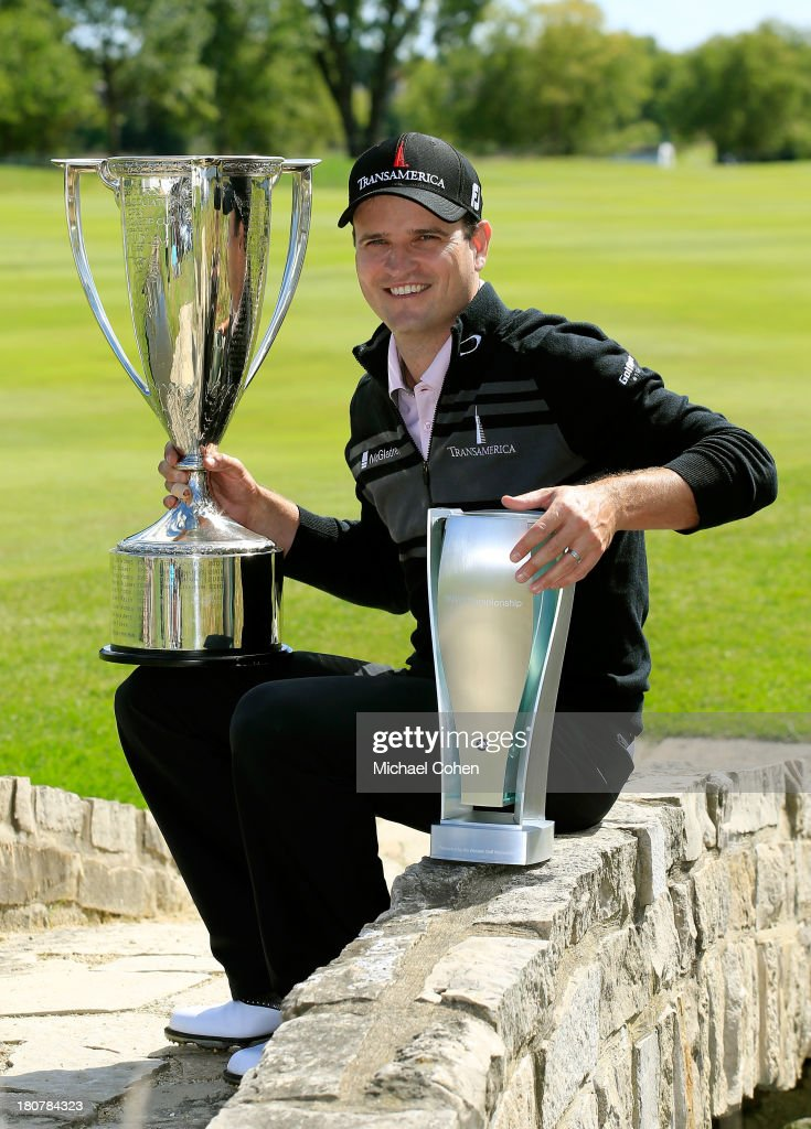Zach Johnson poses with the J.K. Wadley Trophy and BMW Championship Trophy after winning the BMW Championship at Conway Farms Golf Club on September 16, 2013 in Lake Forest, Illinois. Johnson finished with a score of -16.