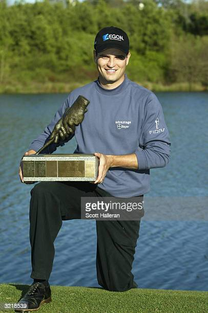 Zach Johnson poses with the trophy after a onestroke victory at the BellSouth Classic at the TPC at Sugarloaf April 4 2004 in Duluth Georgia