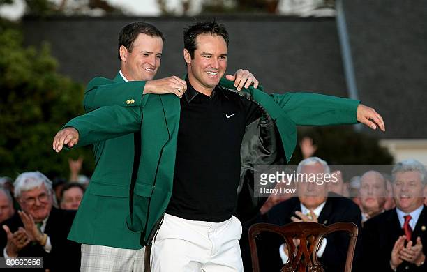 Zach Johnson presents the green jacket to Trevor Immelman of South Africa after Immelman's threestroke victory at the 2008 Masters Tournament at...