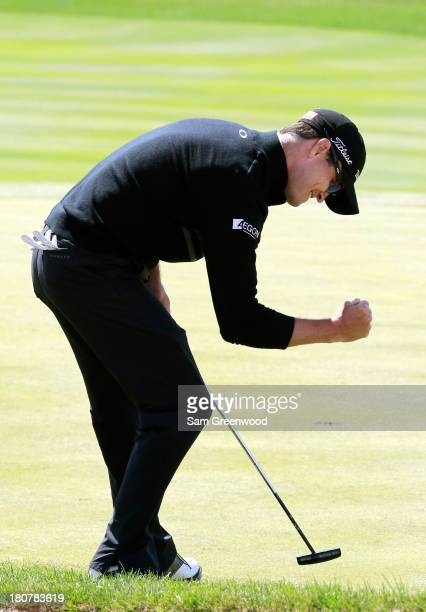 Zach Johnson reacts to a birdie putt on the 16th green during the Final Round of the BMW Championship at Conway Farms Golf Club on September 16, 2013...