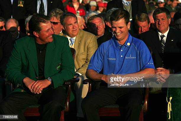 Zach Johnson shares a laugh with Phil Mickelson during the ceremony after winning the 2007 Masters Tournament at Augusta National Golf Club on April...