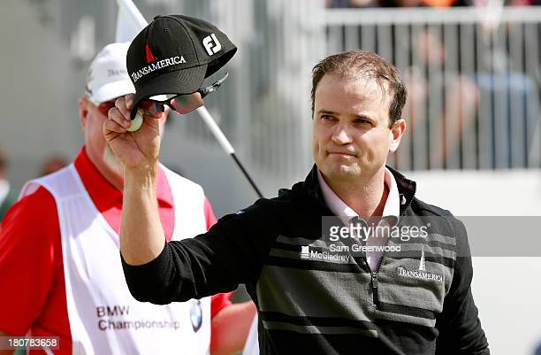 Zach Johnson waves to the crowd after putting on the 1th green during the Final Round of the BMW Championship at Conway Farms Golf Club on September...
