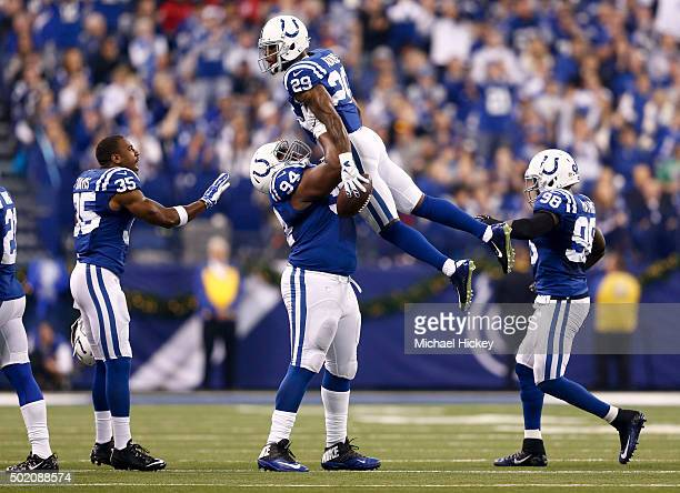 Zach Kerr of the Indianapolis Colts holds up Mike Adams after recovering a fumble during the first quarter against the Houston Texans at Lucas Oil...