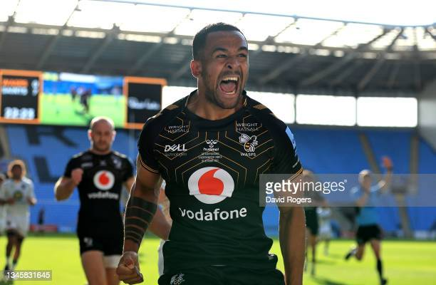 Zach Kibirige of Wasps celebrates after scoring their sides first try during the Gallagher Premiership Rugby match between Wasps and Northampton...