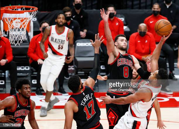 Zach LaVine of the Chicago Bulls defends CJ McCollum of the Portland Trail Blazers in the fourth quarter at Moda Center on January 05, 2021 in...