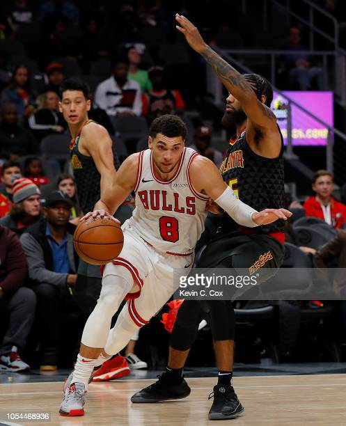 Zach LaVine of the Chicago Bulls drives against DeAndre' Bembry of the Atlanta Hawks at State Farm Arena on October 27 2018 in Atlanta Georgia NOTE...