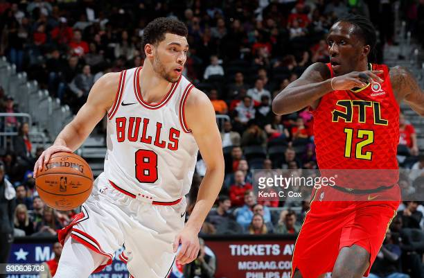 Zach LaVine of the Chicago Bulls drives against Taurean Prince of the Atlanta Hawks at Philips Arena on March 11 2018 in Atlanta Georgia NOTE TO USER...