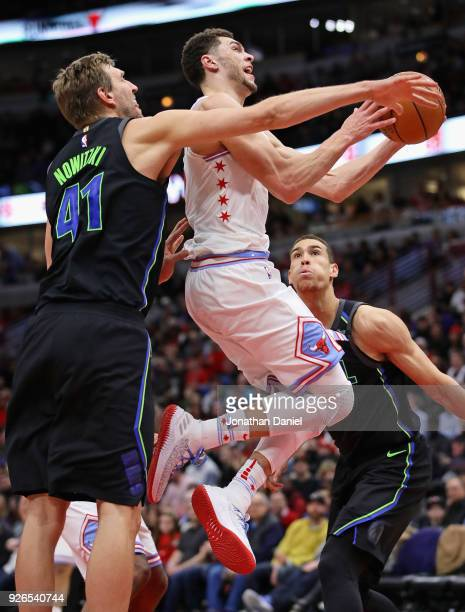 Zach LaVine of the Chicago Bulls drives past Dirk Nowitzki of the Dallas Mavericks at the United Center on March 2 2018 in Chicago Illinois The Bulls...