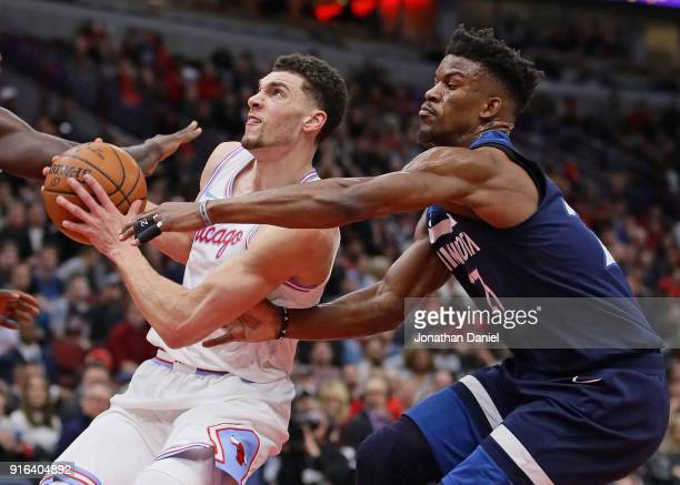 Zach LaVine of the Chicago Bulls drives past Jimmy Butler of the Minnesota Timberwolves at the United Center on February 9 2018 in Chicago Illinois...