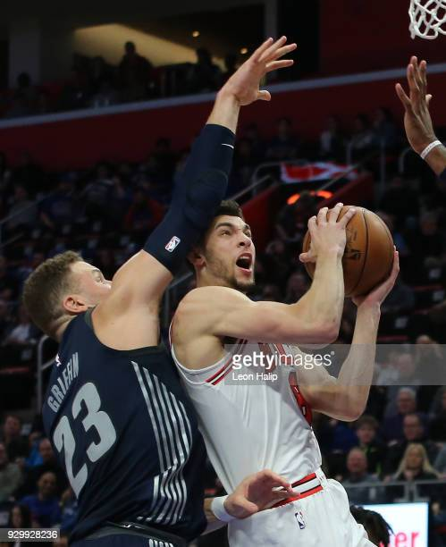 Zach LaVine of the Chicago Bulls drives the ball to the basket as Blake Griffin of the Detroit Pistons defends during the first half of the game at...