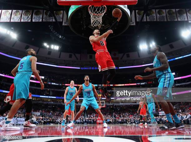 Zach LaVine of the Chicago Bulls drives the lane to put up a shot against the Charlotte Hornets at the United Center on October 24 2018 in Chicago...