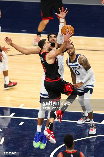 Zach LaVine of the Chicago Bulls drives to the basket while Karl-Anthony Towns of the Minnesota Timberwolves defends in the fourth quarter of the...
