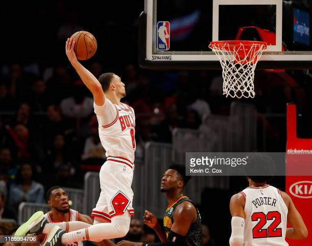 Zach LaVine of the Chicago Bulls dunks against Bruno Fernando of the Atlanta Hawks in the first half at State Farm Arena on November 06 2019 in...