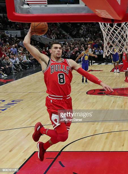 Zach LaVine of the Chicago Bulls goes up for a dunk against the Golden State Warriors at the United Center on January 17 2018 in Chicago Illinois...