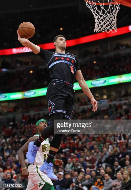 Zach LaVine of the Chicago Bulls goes up for a dunk over Terry Rozier of the Boston Celtics at the United Center on February 23 2019 in Chicago...