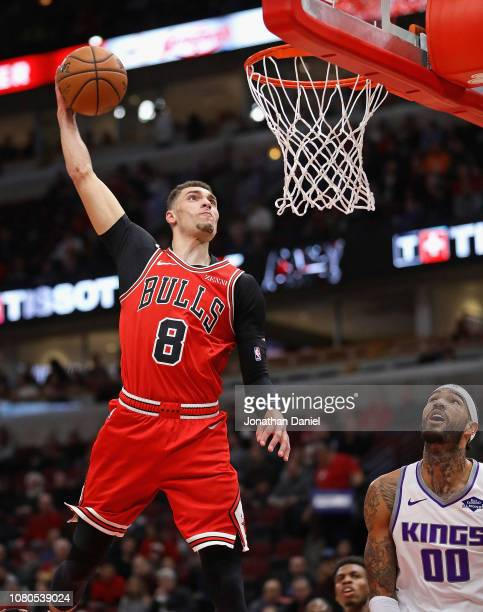 Zach LaVine of the Chicago Bulls goes up for a dunk over Willie Cauley-Stein of the Sacramento Kings at the United Center on December 10, 2018 in...