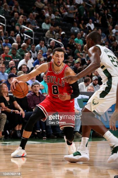 Zach LaVine of the Chicago Bulls handles the ball against the Milwaukee Bucks during a preseason game on October 3 2018 at Fiserv Forum in Milwaukee...